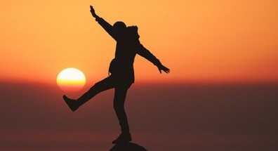 woman-at-sunset-kicking-one-leg